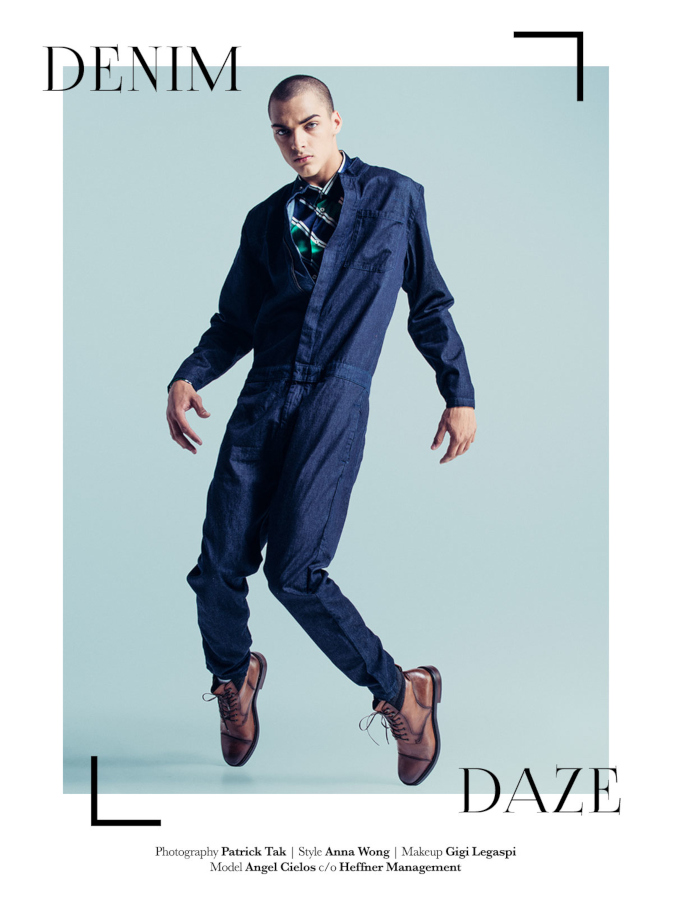 Male model jumping in denim jumpsuit.Latest Magazine. Anna Wong stylist